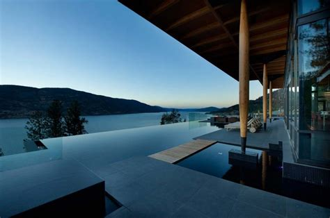 house with a beautiful view stunning lakeside home blends infinity pool with lake and