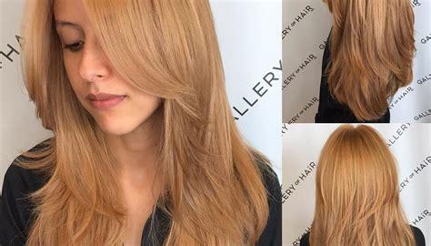Women S Golden Strawberry Blonde Shaggy Layered Cut With   women s golden strawberry blonde shaggy layered cut with