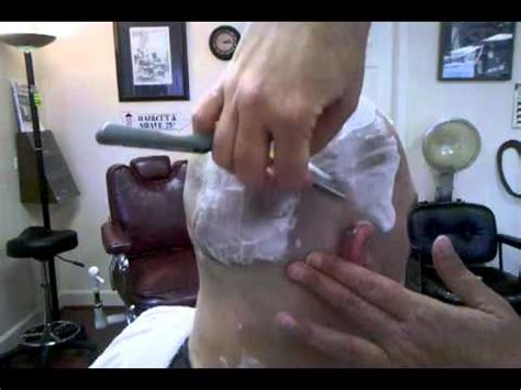 barbershop girls leg shaving women s head shave in a barbershop with a straight razor