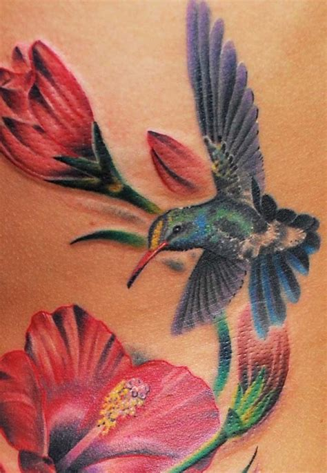 elegant hummingbird with flower tattoo designs