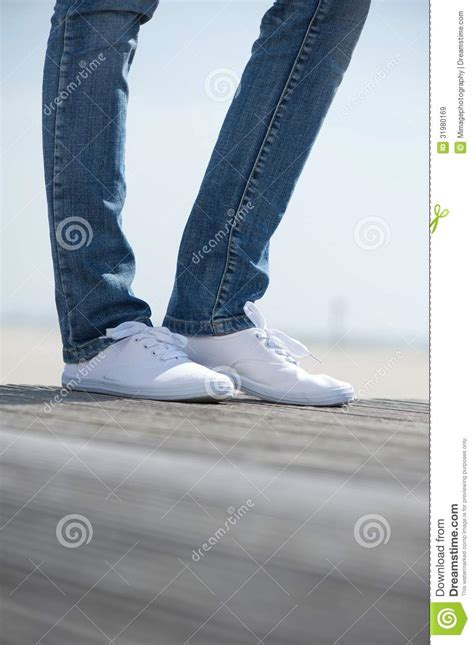 comfortable shoes to stand in female legs standing outdoors in comfortable white shoes
