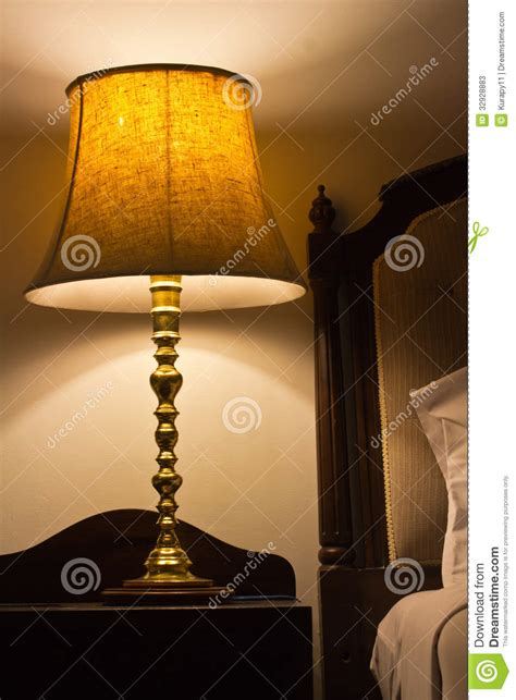 table next to bed l on a night table next to a bed stock photos image