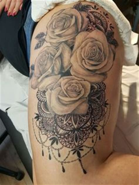 rose tattoo on bum some black and gray roses on hip area cool tattoos