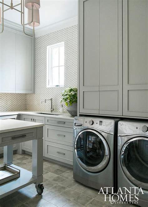 contemporary laundry room cabinets gray laundry room cabinets with silver front load washer