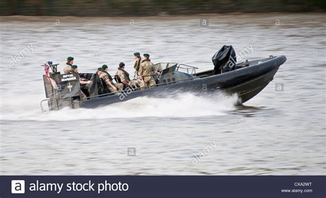 thames river cruise speed boat royal marines in a speed boat on the river thames stock