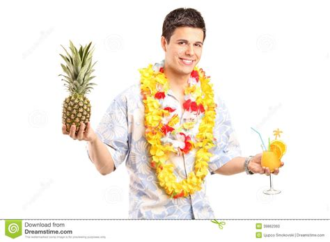man holding martini man holding a pineapple and cocktail stock photo image