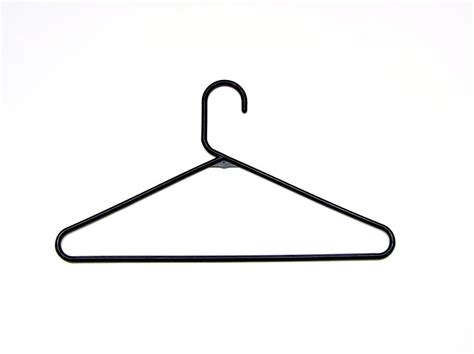 photo hanger hanger free stock photo black plastic coat hanger 1836