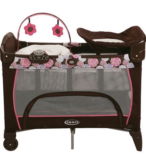 pink and brown graco pack n play with changing table graco pack n play playard with newborn napper station dlx