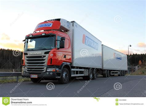 red scania truck and trailer at sunset editorial image
