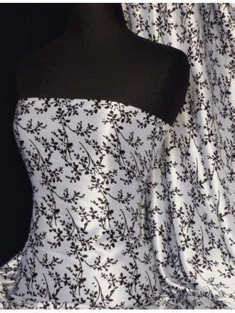Sabrina Ayumi Black N Navy Q sabrina soft satin fabric from fabrics uk