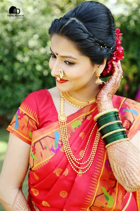 traditional hair maharashtrian bride wearing traditional saree and bridal