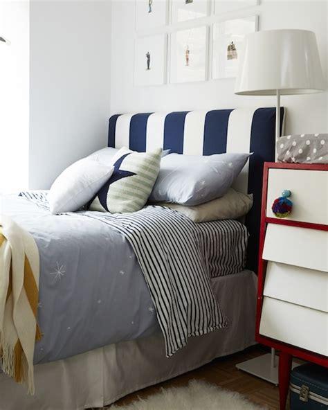 gray kids headboard with blue stripe bedding kids bedding transitional bedroom emily henderson