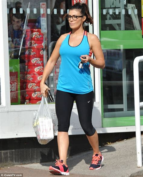 kym marsh 39 shows off her curves in leather pencil skirt kym marsh wears skin tight exercise gearfor grocery run