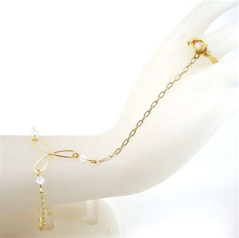 gold bracelet ring attached white crystals bridal