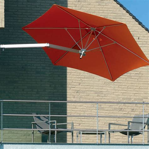 Wall Mounted Patio Umbrella The Wall Mounted Patio Umbrella Hammacher Schlemmer