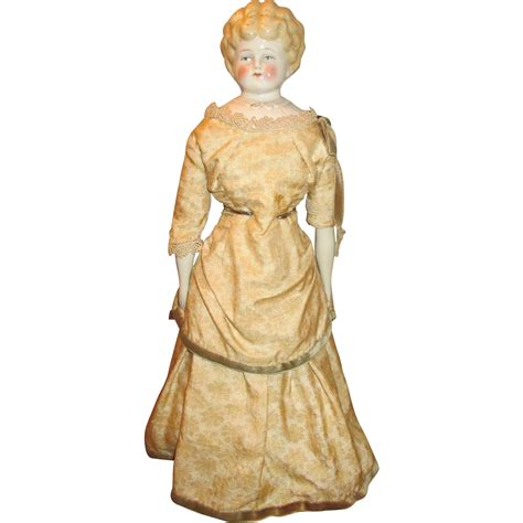 china doll expression antique blond china doll sweet expression