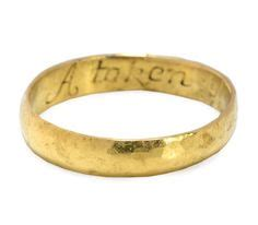 poesy ring in gold with enameled floral engraving inside