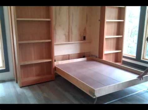 hidden murphy bed bookcase wall unit murphy bed wall bed hidden behind two bookshelves that