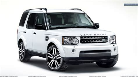 Land Rover Discovery In White Side Front Pose Wallpaper