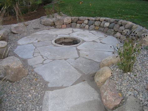 flagstone patio with firepit pits landscape company in western cities metro