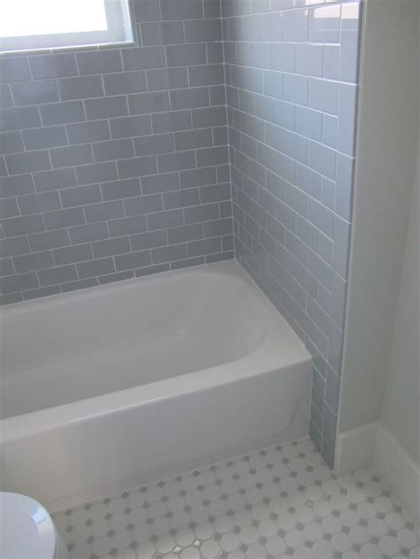 bathrooms with white subway tile did the same 3x6 desert gray subway tile from dal tile but the flooring is different