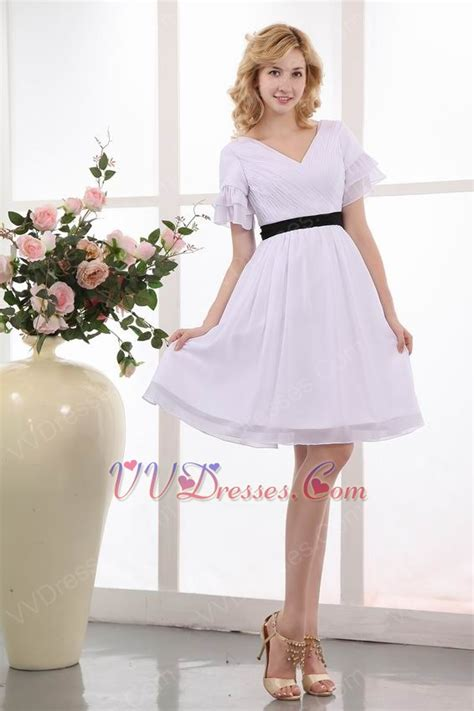 white dress with black belt for of the 100