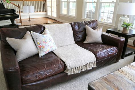 pillows for leather sofa styling your brown leather sofa the decorologist the