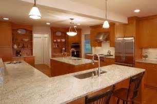 White Transitional Kitchen - kashmir white granite countertops kitchen traditional with counter seating ge monogram