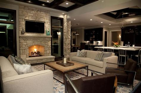 living room with fire place stone fireplace wall with flatscreen tv niche