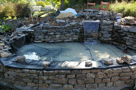 How To Build A Raised Paver Patio Start Of Raised Pond With Patio And Bench