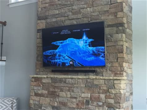 hanging a tv on brick fireplace tv wall mounting nc
