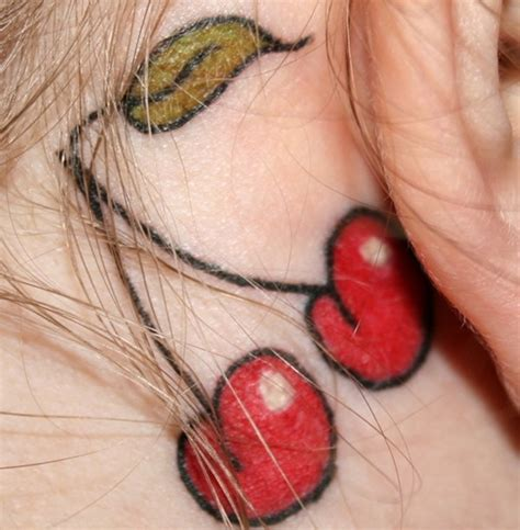 cherry tattoo behind ear meaning classy looking behind the ear tattoo behind the ear