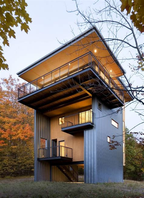 home design by 4 storey house reaches above the forest to see the lake modern house designs