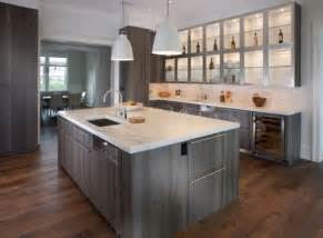 Gray Kitchen Cabinet Ideas by Green Gray Cabinets Light Up This Compact Kitchen In A