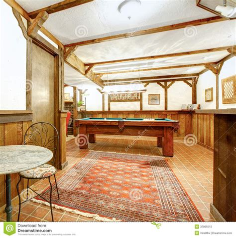 family area rustic wooden living room bar room and pool table stock