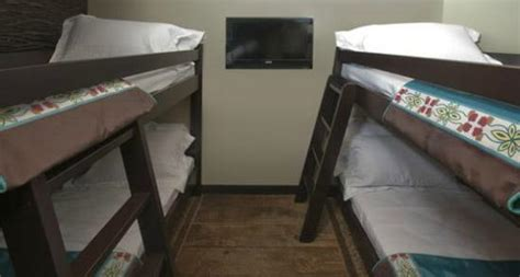 soaring eagle waterpark rooms eagle s nest suites feature a separate room for the with bunk beds a table and chairs and