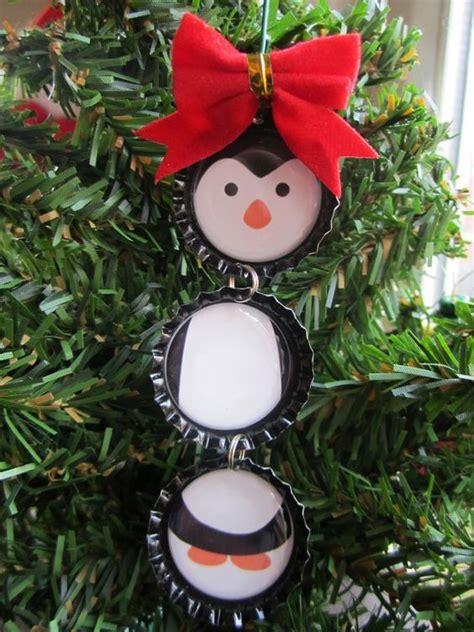 diy penguin christmas ornament using bottle caps
