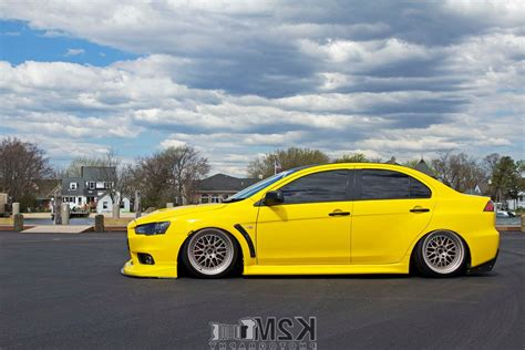 mitsubishi yellow car yellow cars mitsubishi lancer evo x vehicle 187 car