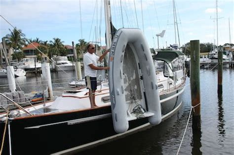 living on a boat tips how to put the dinghy on deck boat living tips