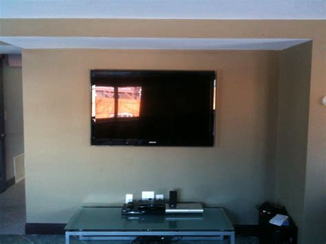 50 inch tv in small room classic family room ideas with led plasma 50 inch tv wall mount and brown wall painted design