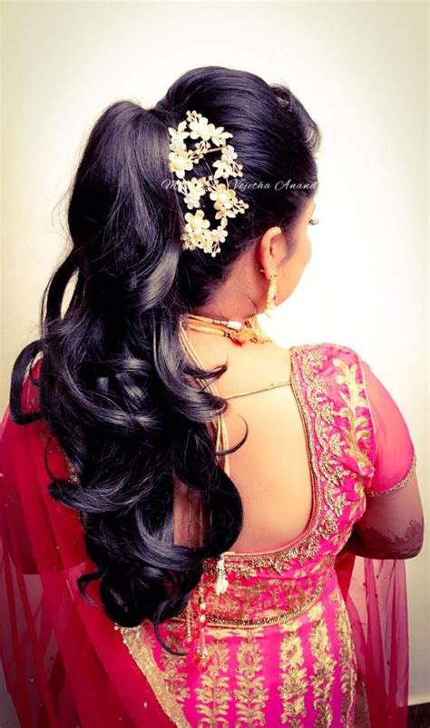 indian hairstyles with lehenga indian bride s reception hairstyle by swank studio bridal