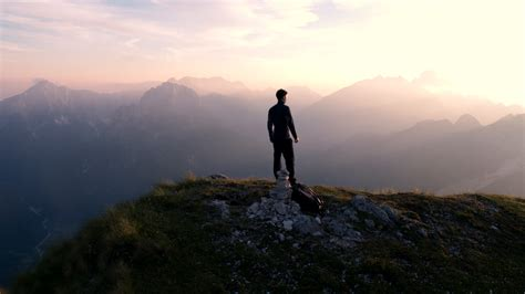 man standing on mountain top man standing on mountain top man standing on top of