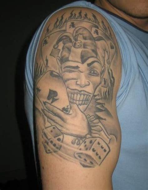 upper arm tattoo jobs grey ink joker n dice tattoo on upper arm tattoos book