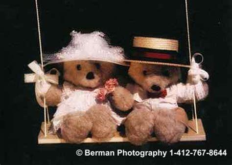 swinging teddy bears on swing
