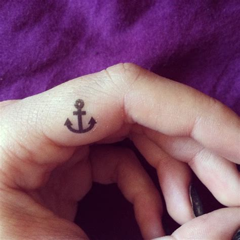 anchor finger tattoo beautiful tiny anchor on finger side tattooshunt
