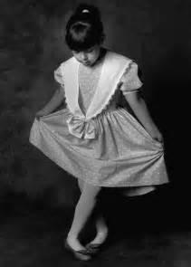Large b w photo of girl curtseying