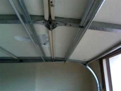Garage Door Top Strut by Garage Door Strut Repair Mov