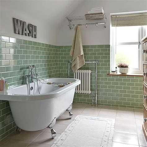 green tiled bathroom with rolltop bath bathroom