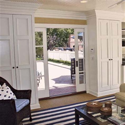 divided light pocket doors from garage to comfy rec room this house