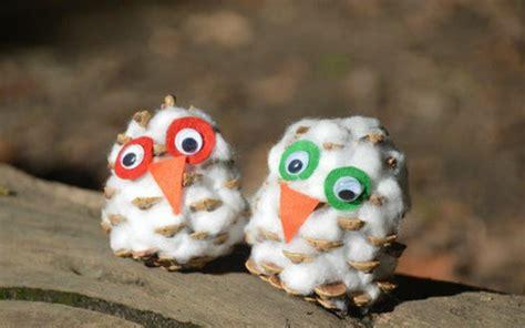 Tippytoe Crafts Pine Cone Snowy Owls - birds nest project allfreekidscrafts